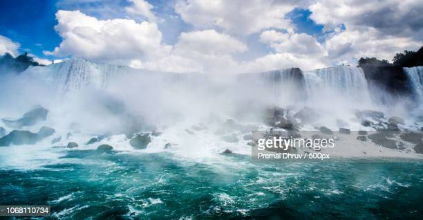 scenic view of niagara falls on sunny day - niagara falls stock pictures, royalty-free photos & images