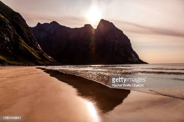 scenic view of nordic sea at kvalvika beach during summertime. - rachel wolfe stock pictures, royalty-free photos & images