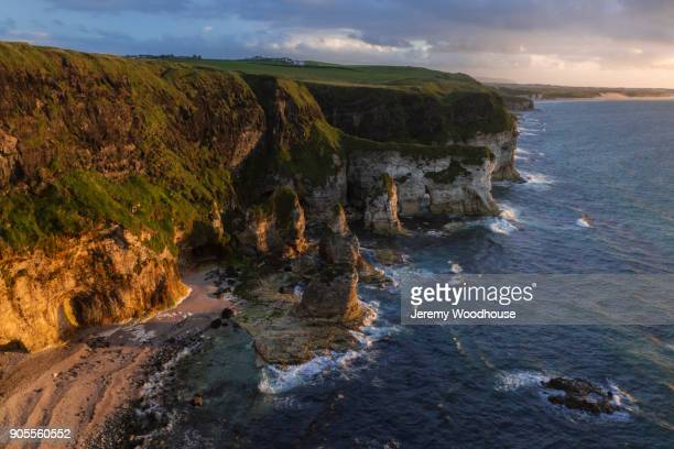 scenic view of ocean cove - county antrim stock pictures, royalty-free photos & images