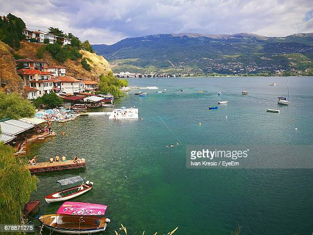 scenic view of ohrid lake and mountains - lake ohrid stock photos and pictures