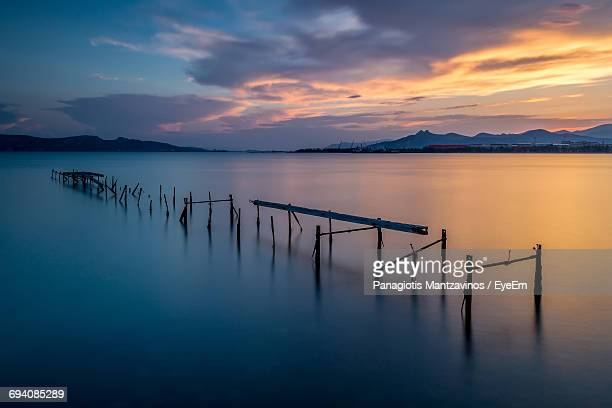 Scenic View Of Old Pier Against Sky During Sunset