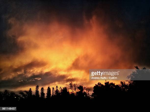 scenic view of orange clouds during sunset - andres ruffo stock-fotos und bilder