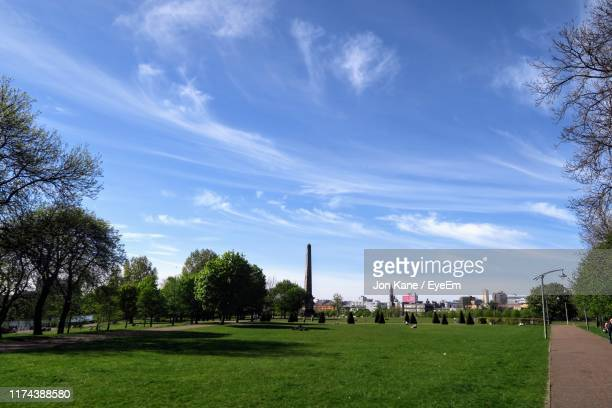 scenic view of park against sky - glasgow green stock pictures, royalty-free photos & images