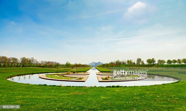 scenic view of park against sky - venaria reale stock photos and pictures