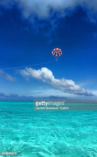 Scenic View Of People Parasailing