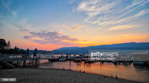scenic view of pier at sunset - kelowna stock pictures, royalty-free photos & images