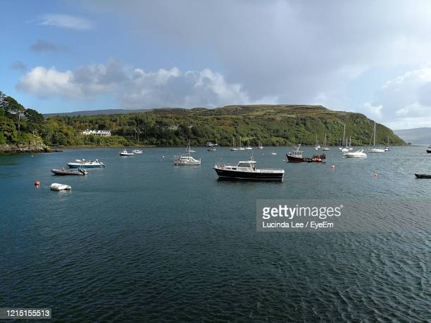 scenic view of portree harbour against sky - lucinda lee stock pictures, royalty-free photos & images