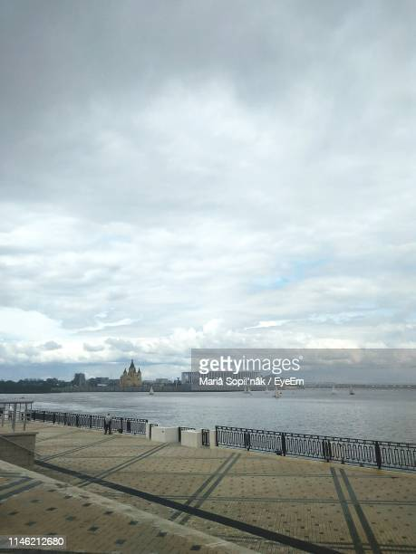 scenic view of promenade by sea against sky - nizhny novgorod oblast stock photos and pictures
