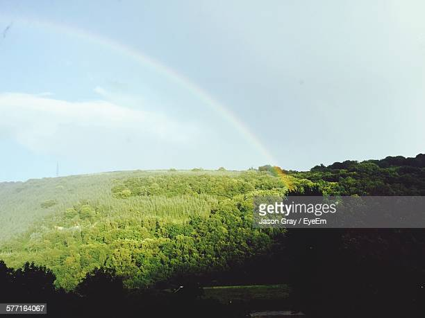 scenic view of rainbow on field against sky - abertillery stock photos and pictures