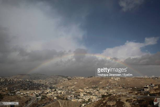 Scenic View Of Rainbow Over City Against Sky