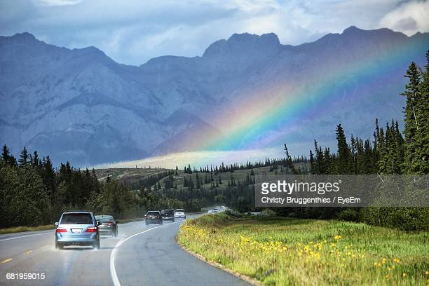 Scenic View Of Rainbow Over Country Highway