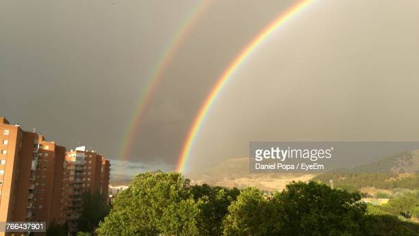 scenic view of rainbow over mountain against sky - alcala de henares stock pictures, royalty-free photos & images