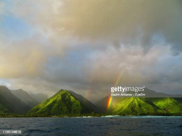 scenic view of rainbow over mountains against sky - antonov stock pictures, royalty-free photos & images