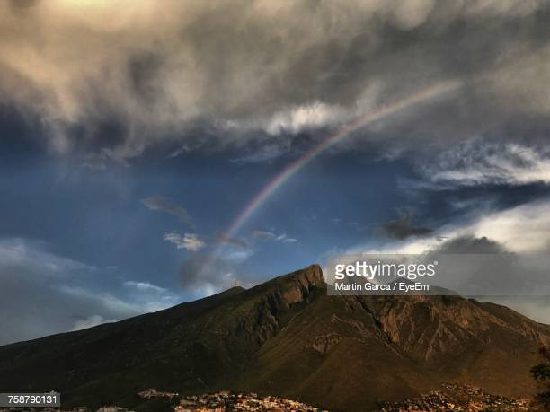 scenic view of rainbow over mountains against sky - nuevo leon state stock pictures, royalty-free photos & images