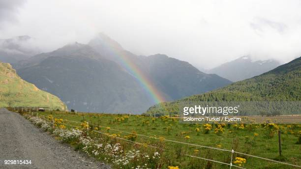 scenic view of rainbow over mountains against sky - solomon turkel stock pictures, royalty-free photos & images