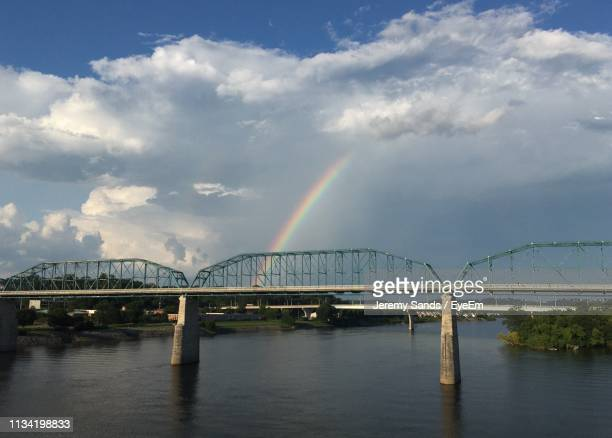 scenic view of rainbow over river against sky - chattanooga stock pictures, royalty-free photos & images