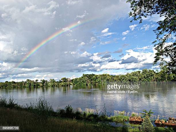 scenic view of rainbow over river against sky - rachel wolfe stock pictures, royalty-free photos & images