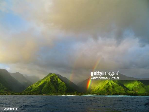 scenic view of rainbow over sea against sky - antonov stock pictures, royalty-free photos & images