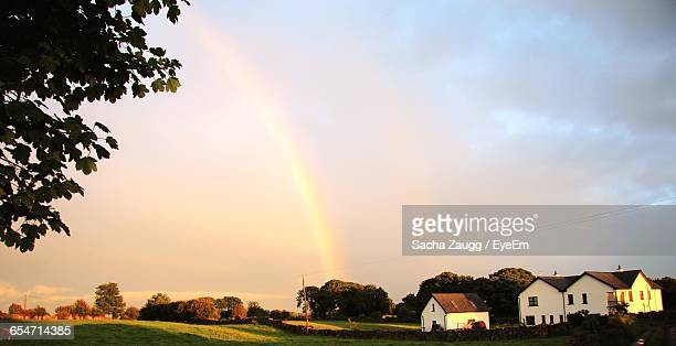Scenic View Of Rainbow Over Village Against Sky