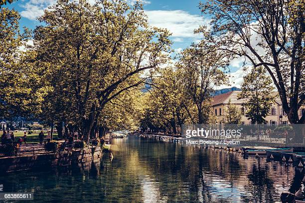 scenic view of reflection of treelined canal - annecy fotografías e imágenes de stock