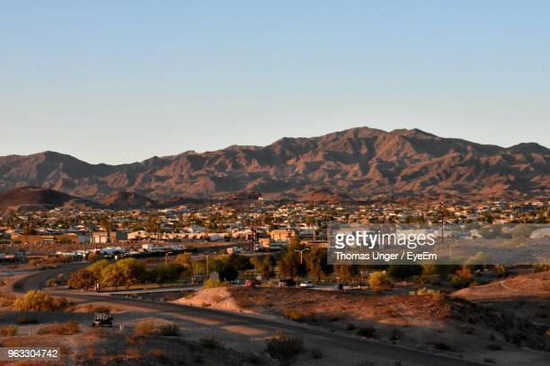 scenic view of residential district against clear sky - lake havasu stock photos and pictures
