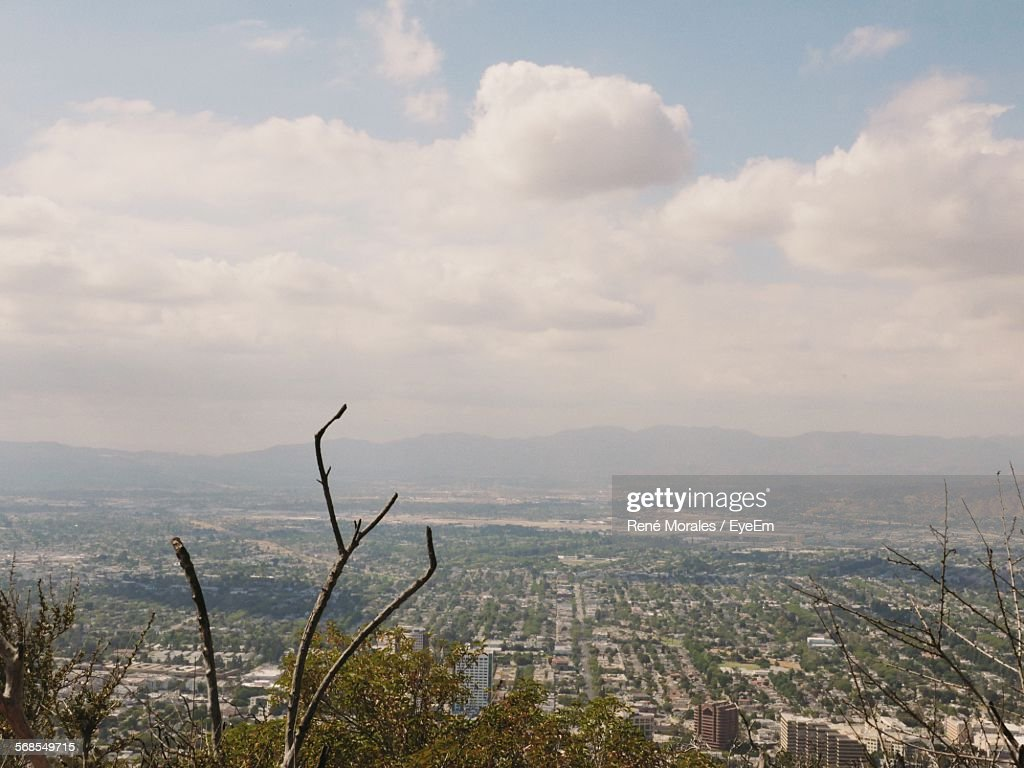 Scenic View Of Residential District Against Cloudy Sky : Stock Photo