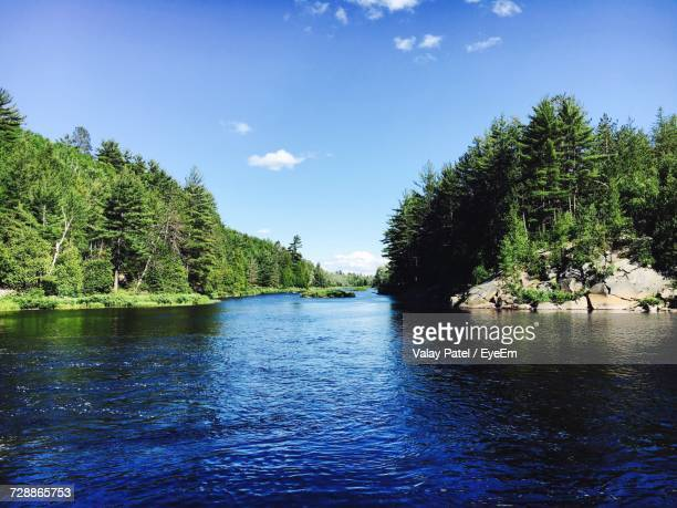 scenic view of river against blue sky - sudbury canada stock photos and pictures