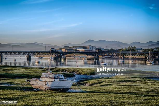 scenic view of river against blue sky - barrow in furness stock photos and pictures