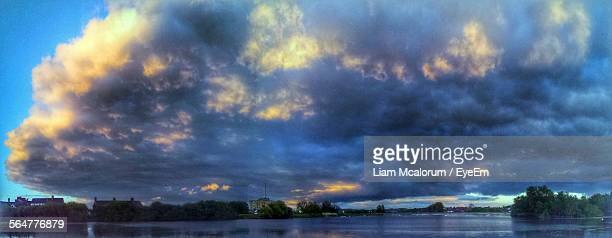 Scenic View Of River Against Cloudy Blue Sky At Dusk