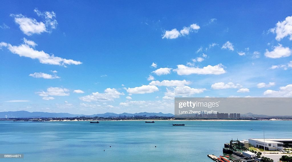 Scenic View Of River Against Cloudy Blue Sky : Stock Photo