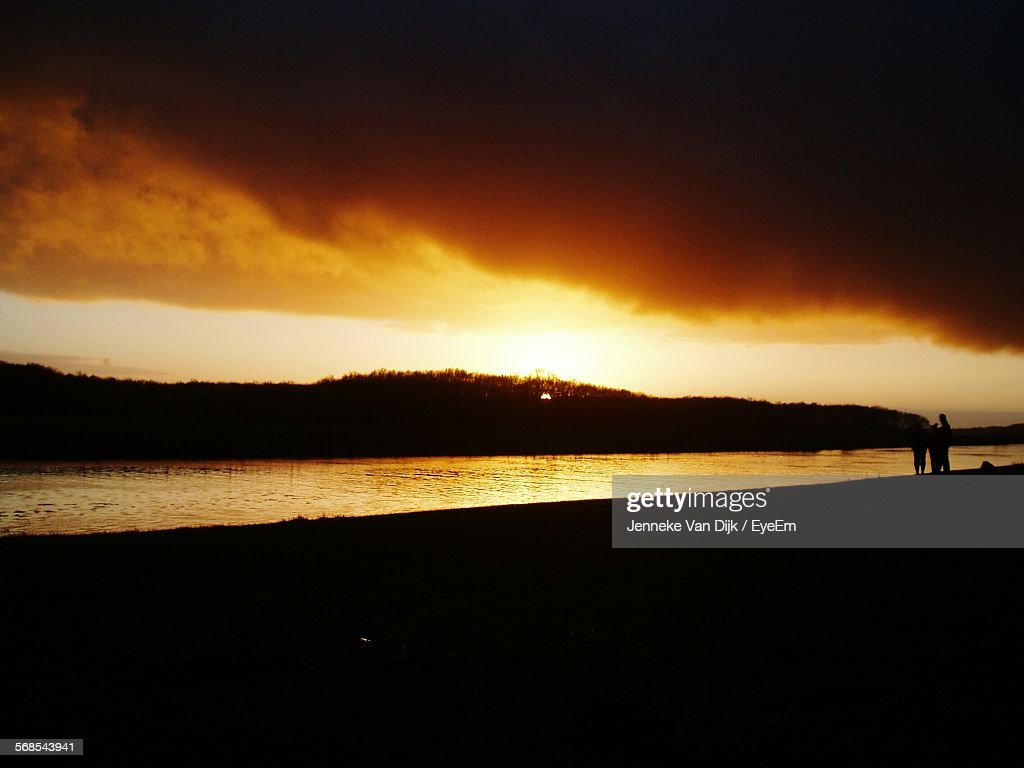 Scenic View Of River Against Cloudy Sky At Sunset : Stock Photo
