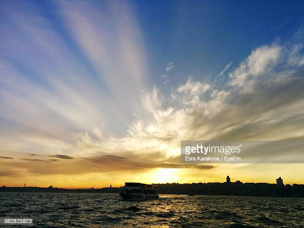 Scenic View Of River Against Cloudy Sky During Sunset