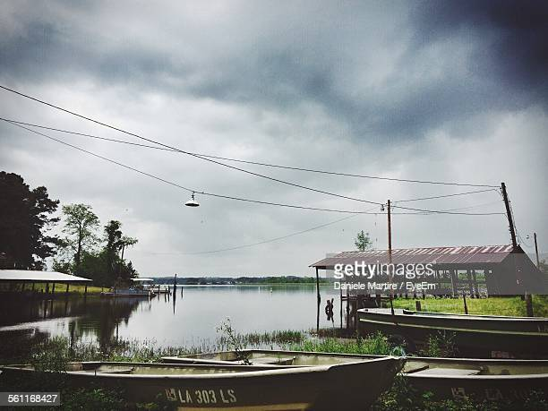 scenic view of river against cloudy sky - shreveport stock pictures, royalty-free photos & images