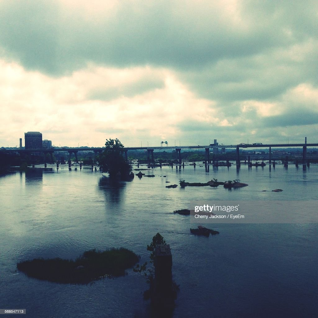 Scenic View Of River Against Cloudy Sky : Stock Photo