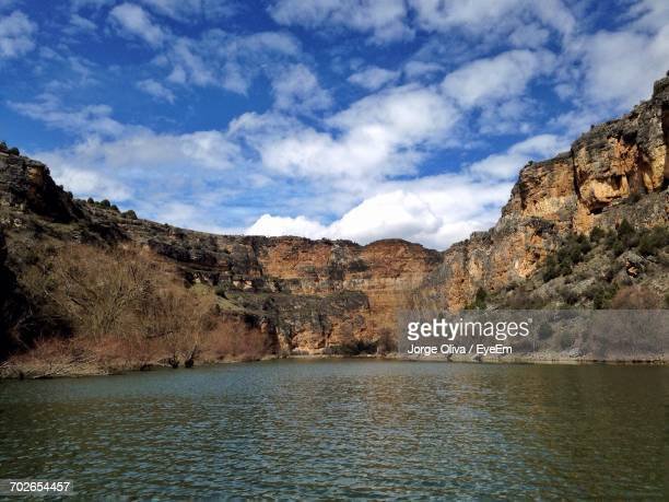 scenic view of river against cloudy sky - segovia stock pictures, royalty-free photos & images