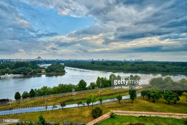 scenic view of river against cloudy sky - belgrade stock pictures, royalty-free photos & images