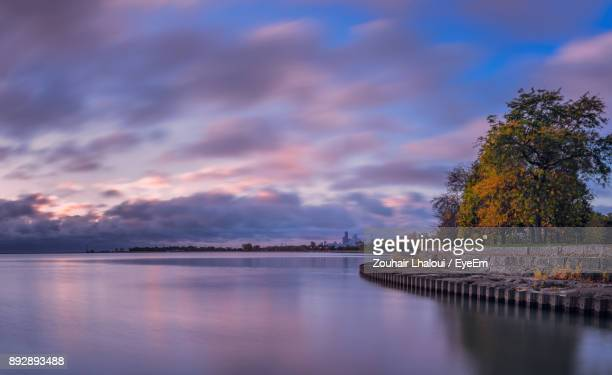 scenic view of river against cloudy sky - cook county illinois stock photos and pictures