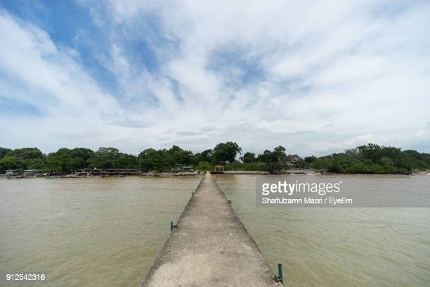 scenic view of river against cloudy sky - shaifulzamri stock pictures, royalty-free photos & images