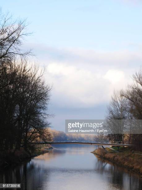 scenic view of river against cloudy sky - sabine hauswirth stock pictures, royalty-free photos & images