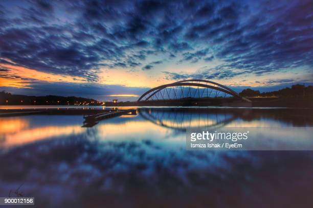 Scenic View Of River Against Dramatic Sky