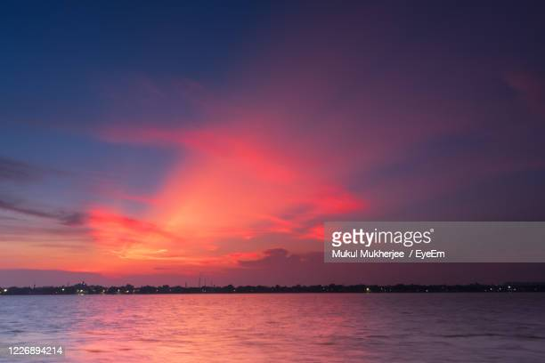 scenic view of river against romantic sky at sunset - romantic sunset stock pictures, royalty-free photos & images