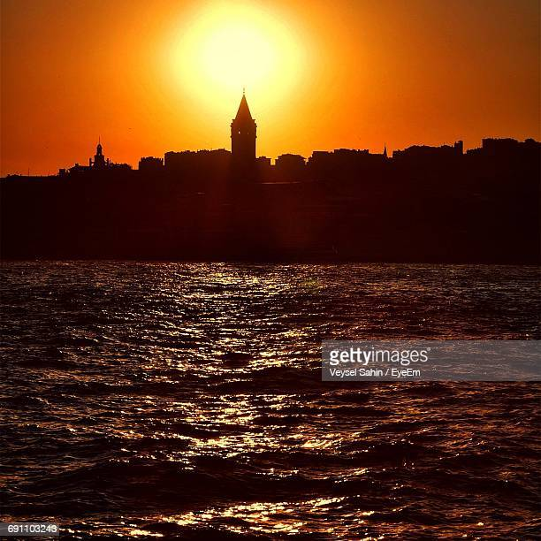 Scenic View Of River Against Silhouette Galata Tower In City During Sunset