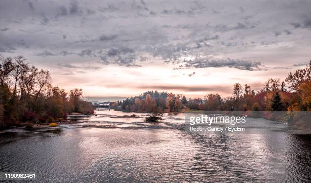 scenic view of river against sky at sunset - eugene oregon stock pictures, royalty-free photos & images
