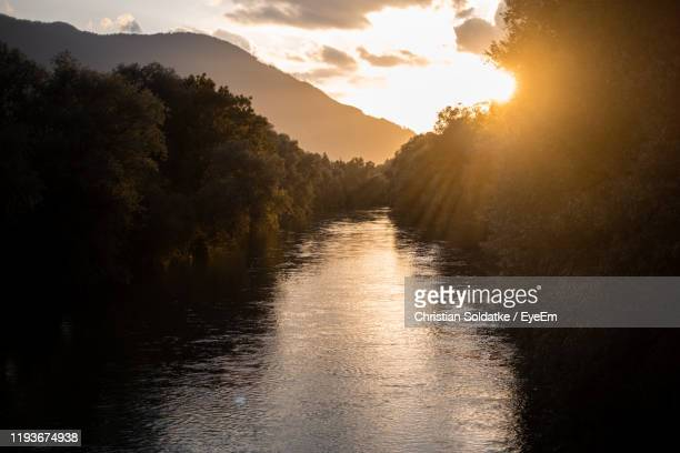 scenic view of river against sky during sunset - christian soldatke stock pictures, royalty-free photos & images