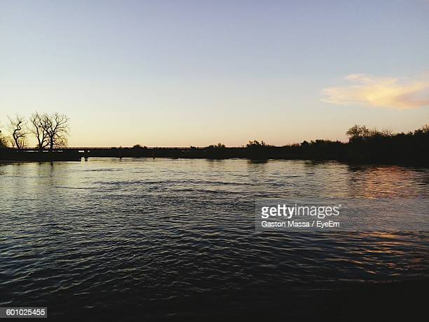 scenic view of river against sky during sunset - massa stock pictures, royalty-free photos & images
