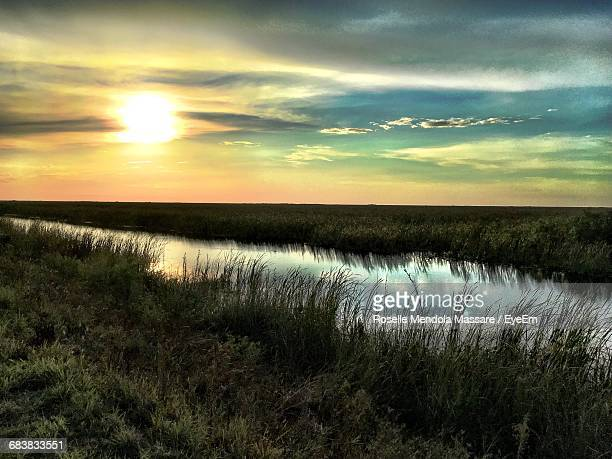 scenic view of river against sky during sunset - coral springs stock pictures, royalty-free photos & images