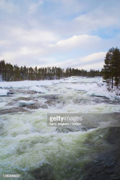 scenic view of river against sky during winter - climat stock pictures, royalty-free photos & images