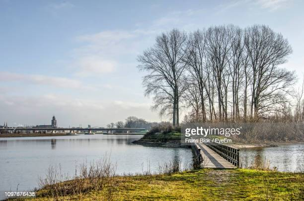 scenic view of river against sky - deventer stock photos and pictures