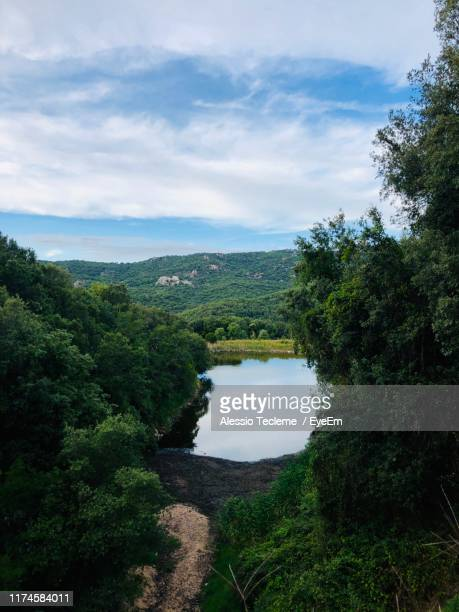 scenic view of river against sky - tempio pausania stock pictures, royalty-free photos & images
