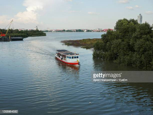 scenic view of river against sky - apisit hiranpornpan stock pictures, royalty-free photos & images